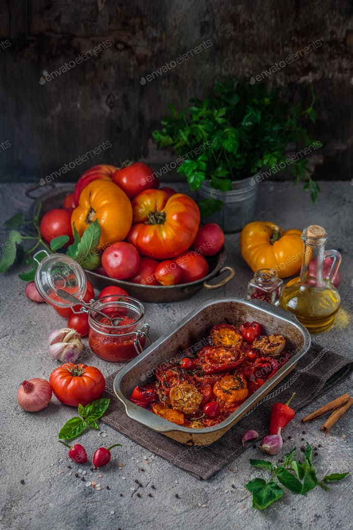 Tomato sauce making process with baked tomatoes, copy space