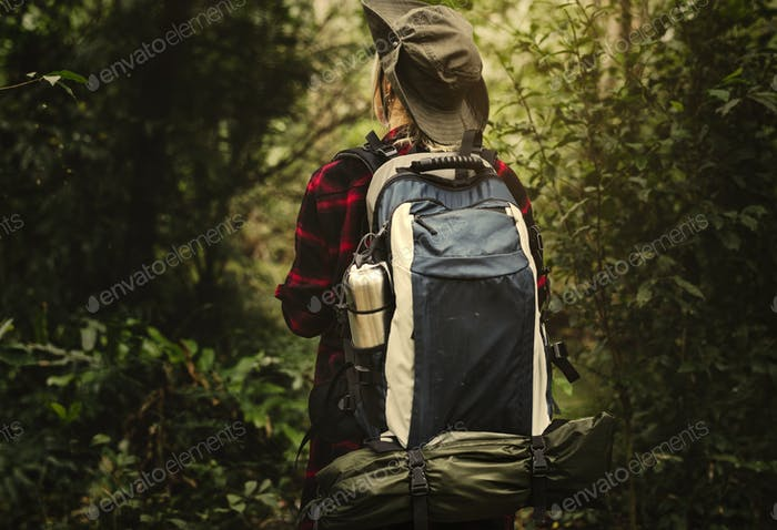 Woman trekking in a forest