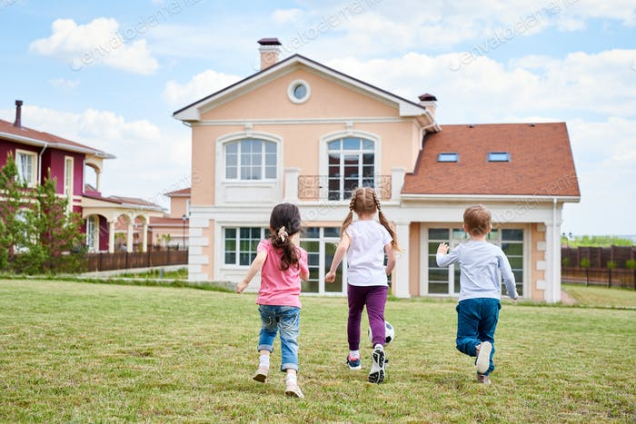 Children Playing by Beautiful House