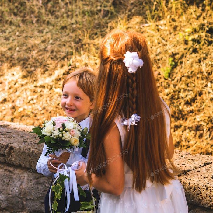 Ring bearer and flower girl at summer wedding