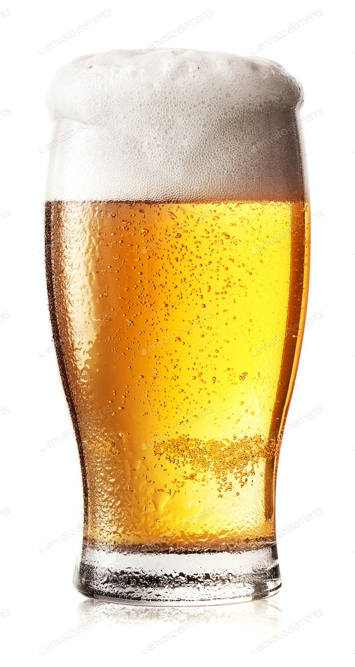 Glass of light beer with foam and drops