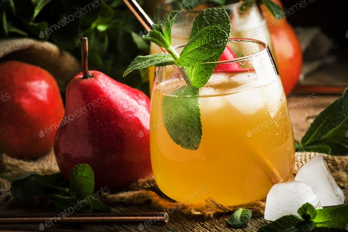 Cold pear juice, iced summer non-alcoholic cocktail with mint