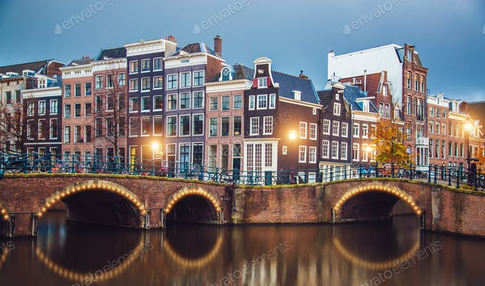 Stunning Amsterdam canals and typical dutch houses in capital of Netherlands, Europe