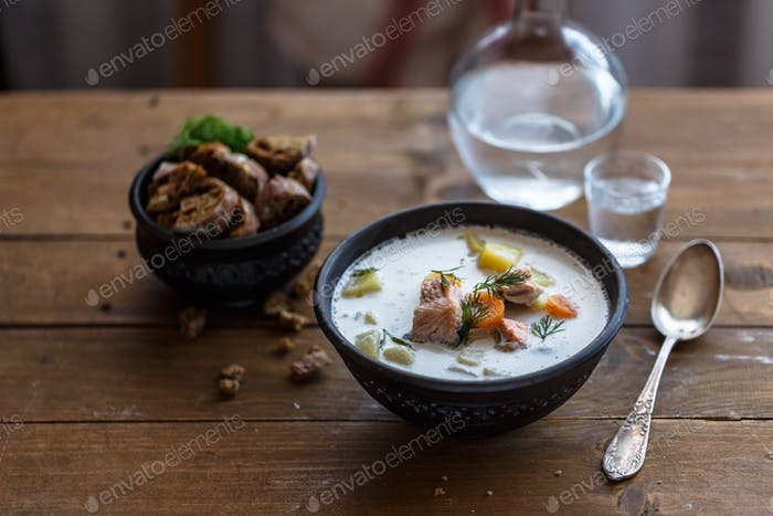 Salmon soup. Finnish salmon soup with cream Lohikeitto