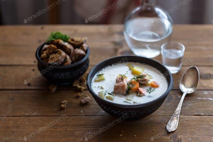 Salmon soup. Finnish salmon soup with cream Lohikeitto