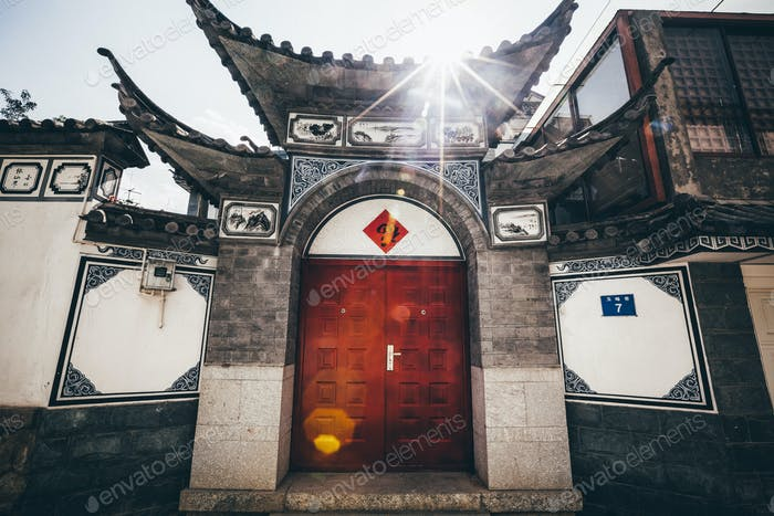 Exterior view of front door and roof of a traditional Chinese residential building.