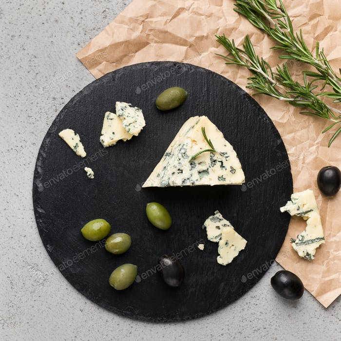 Blue cheese on black board