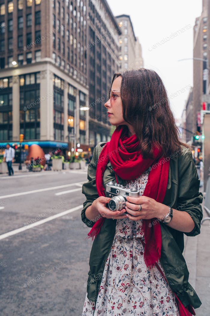 Young woman with a retro camera in New York