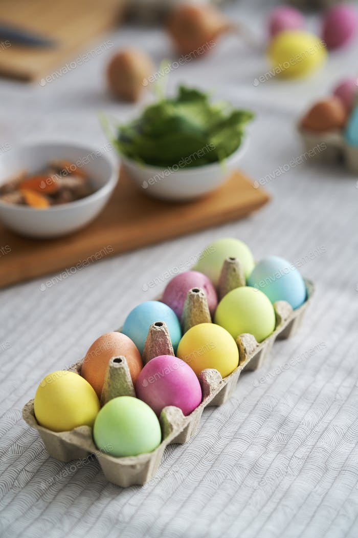 Top view of Easter eggs carton on the table