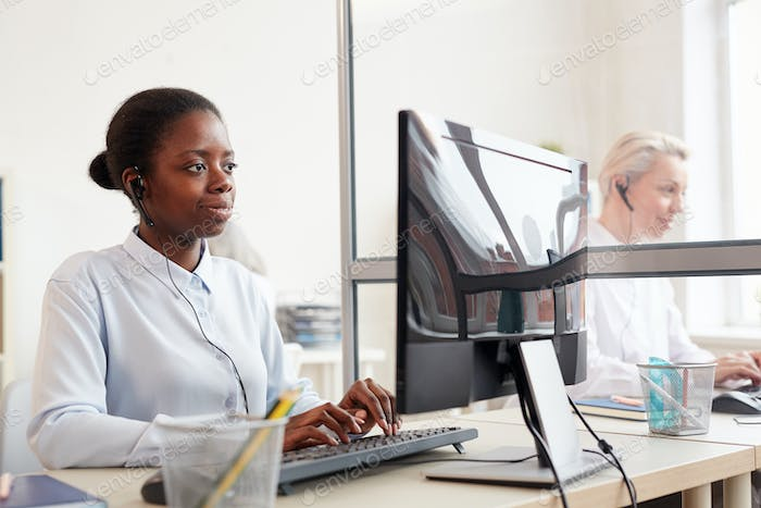 African-American Operator Working in Customer Support Center