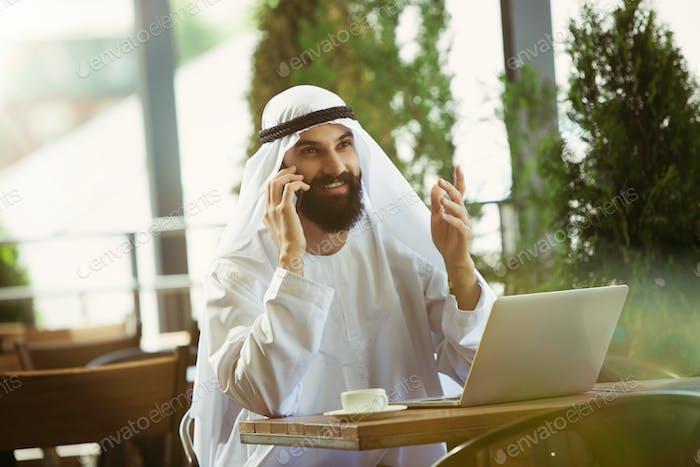 Arabian saudi businessman working outdoors