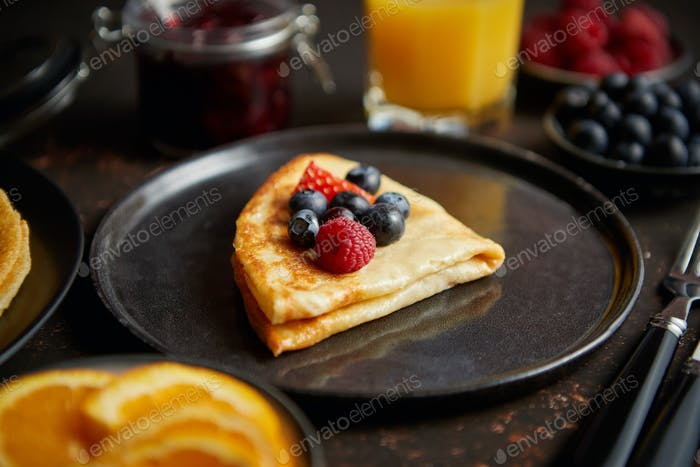 Tasety homemade pancake on black ceramic plate
