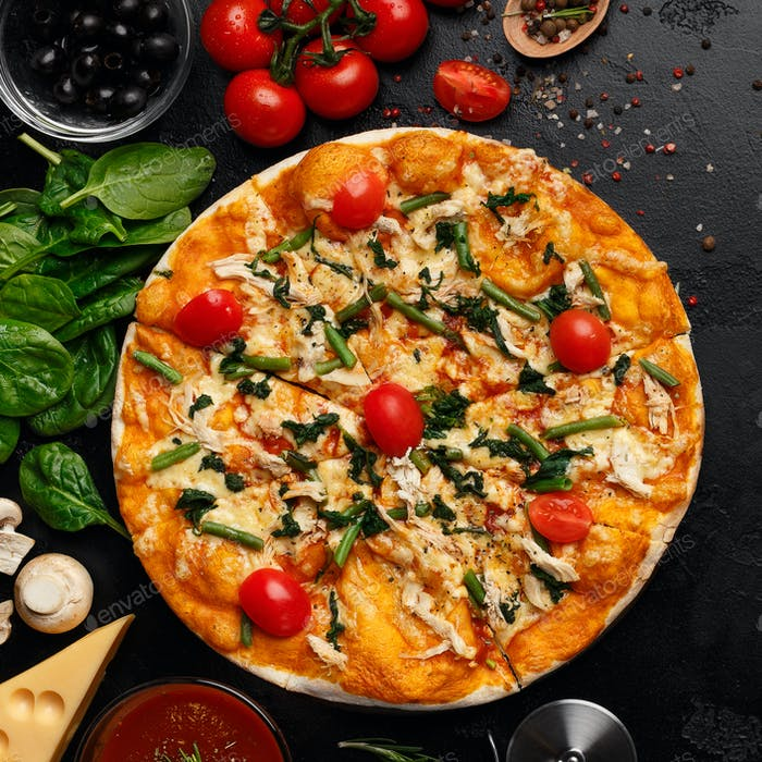Pizza with cheese, cherry tomatoes and rocked salad