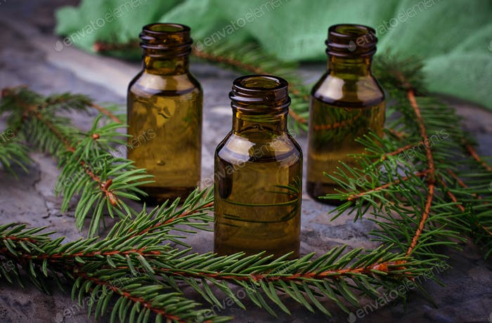 Fir tree essential oil in small bottles