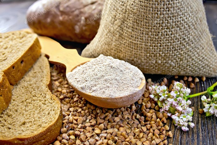 Flour buckwheat in spoon with cereals and bread on board