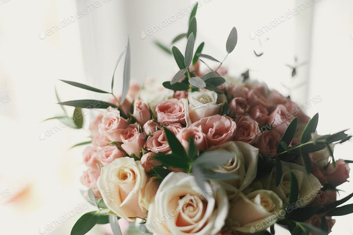 Beautiful gentle wedding bouquet with big and little pink roses