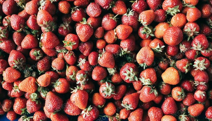Close up image of lot of fresh strawberries