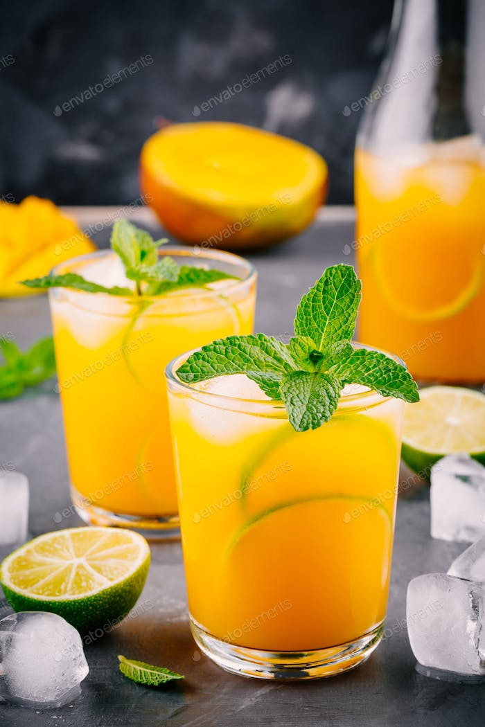 Fresh summer mango cocktail with lime and mint