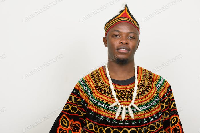 Happy young handsome African man wearing traditional clothing