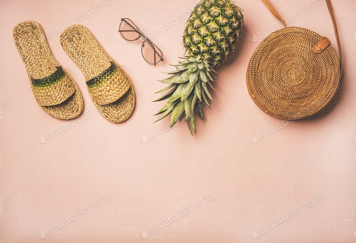 Variety of summer apparel fashionable items over pastel background