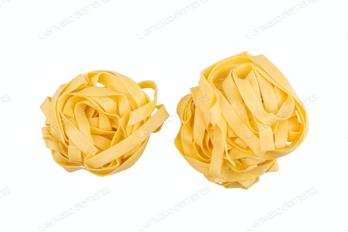 two balls of tagliatelle pasta isolated on white