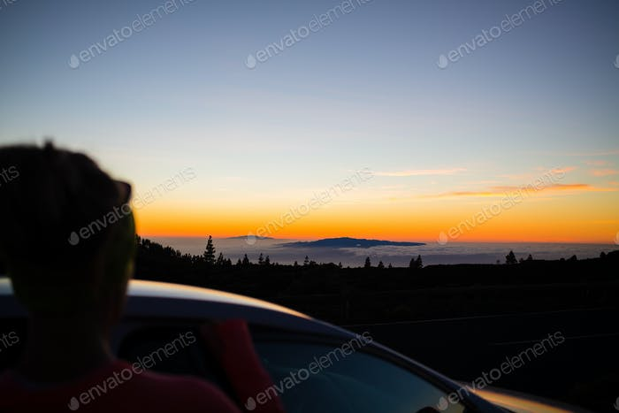 Woman looking at inspirational landscape ocean view