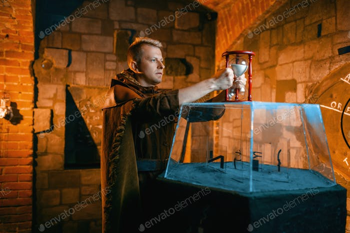Traveler holds sandglass in the temple dungeon