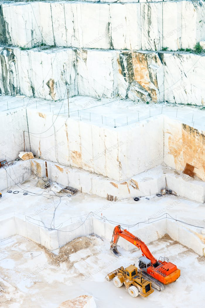White marble quarry and excavators. Carrara, Italy