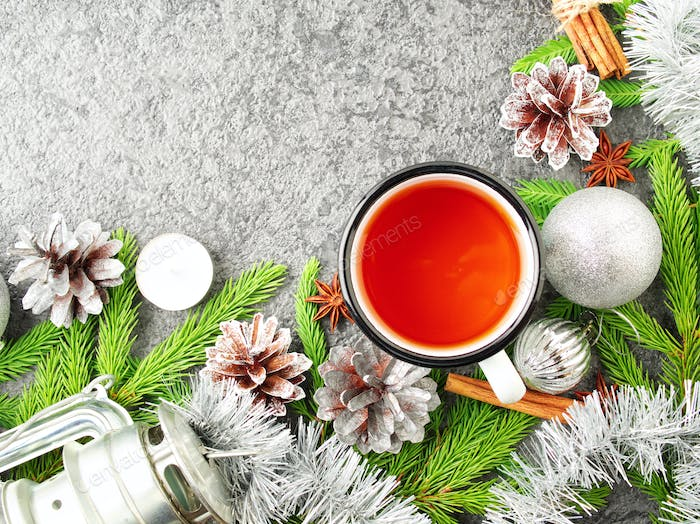 Christmas and Happy New Year background with tea. Top view, copy space, military stile.