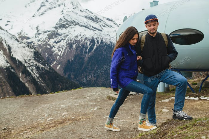 young hipster couple in love on winter vacation in mountains