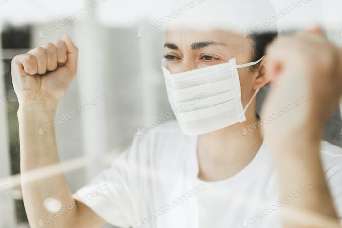 Angry patient in hospital coronavirus quarantine self isolation want to go outside