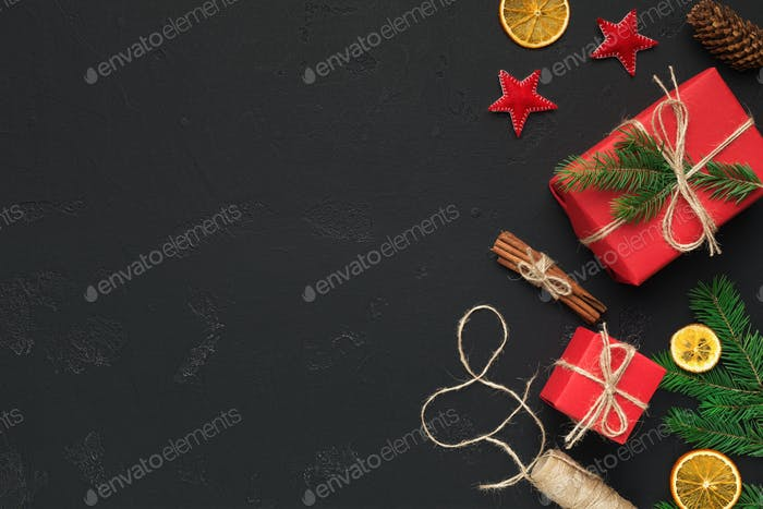 Christmas festive gift boxes and decorations on black background