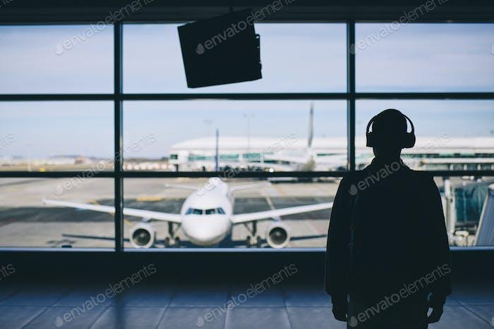 Traveler with headphones
