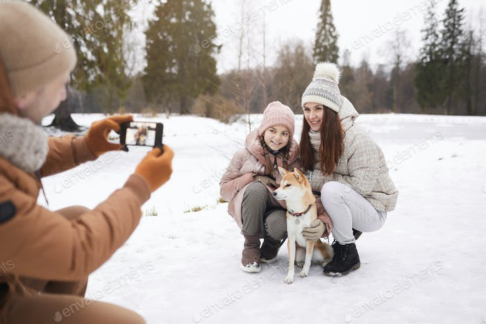 Family Taking Photos in Winter Park