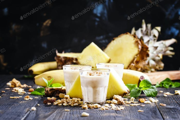 Milkshake with banana, pineapple, yogurt and muesli