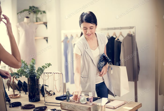Customer checking out clothes