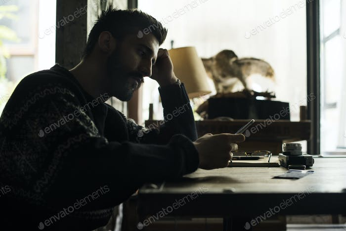 A man holding using smartphone