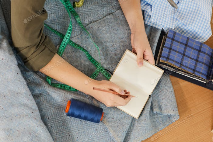 Student learning to sew