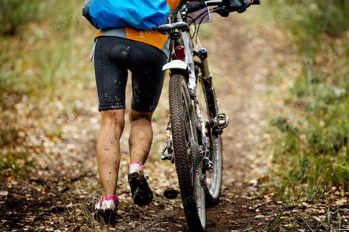 Mountain Biking in Autumn Forest