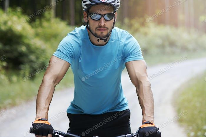 Pensive man riding a bike