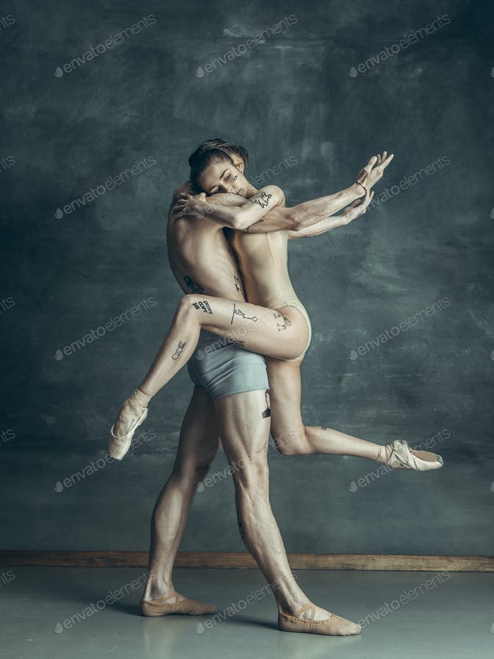 Thumbnail for The young modern ballet dancers posing on gray studio background