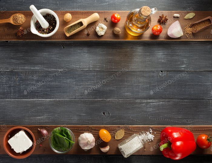 spice, herbs and food ingredients on wood