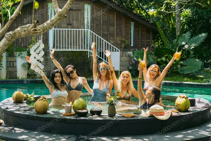 beautiful young women having fun together at pool party