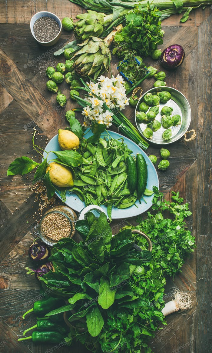 Spring healthy vegan food cooking ingredients, wooden background, vertical composition