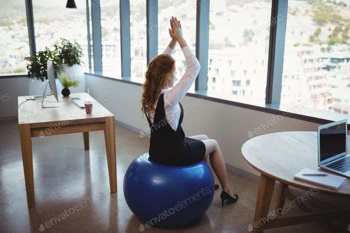 Executive exercising on fitness ball