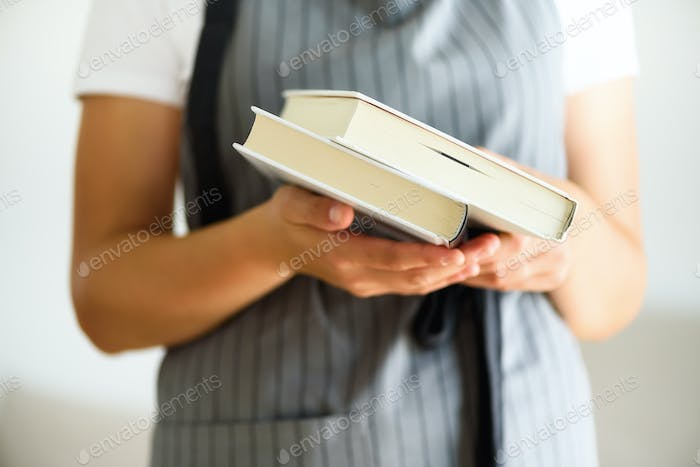 Young girl in white T-shirt reading opened book. Copy space. lifestyle and school concept