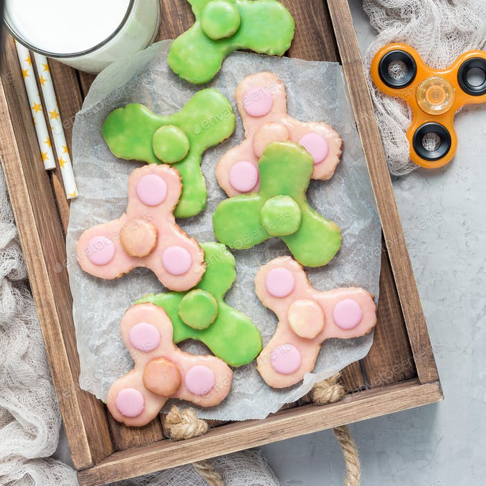 Homemade shortbread cookies made in trendy spinner toy form, top view, square format