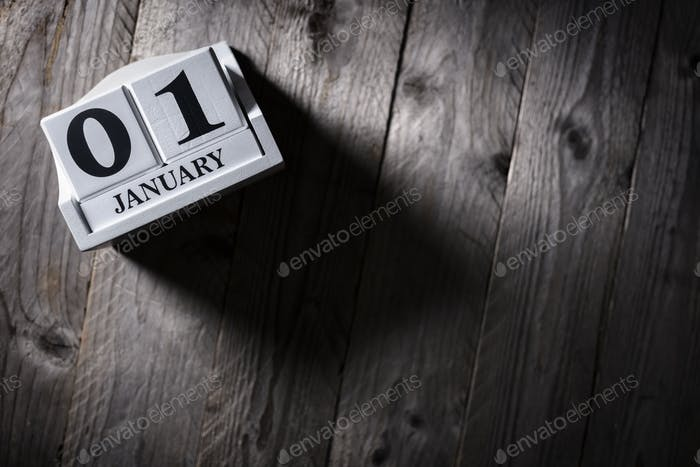 January 1st calendar on wood background concept for new year