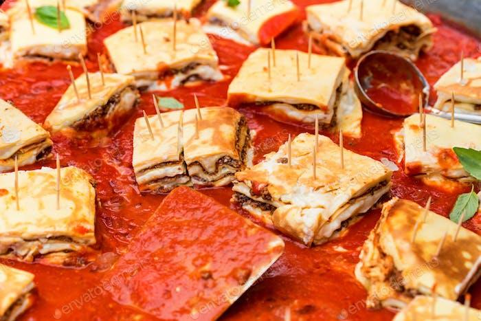Close-up of tasty lasagna in baking dish