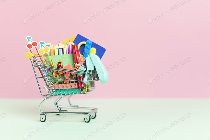 Shopping trolley full of school supplies. Preparation to school, shopping, sale, deals, discounts